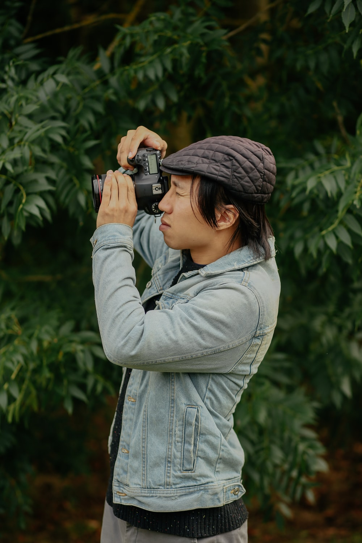man wearing grey jacket taking picture