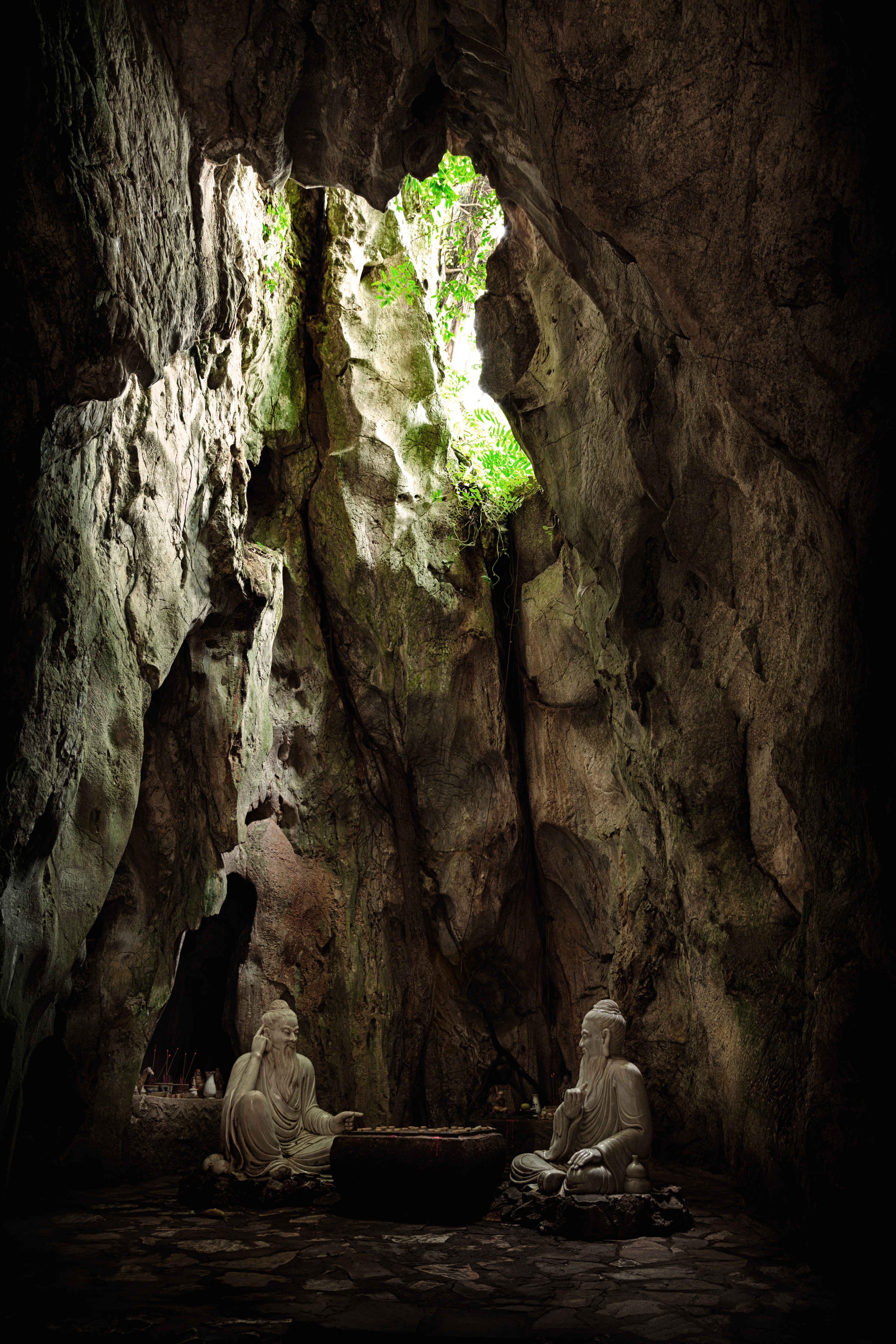 two statues in cave
