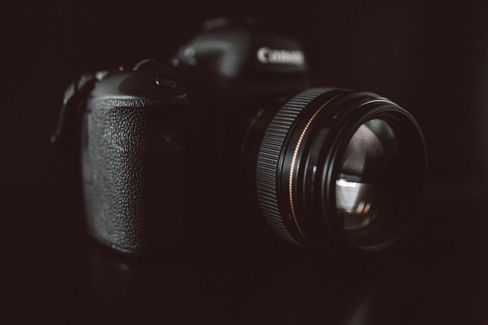 shallow focus photo of Canon DSLR camera