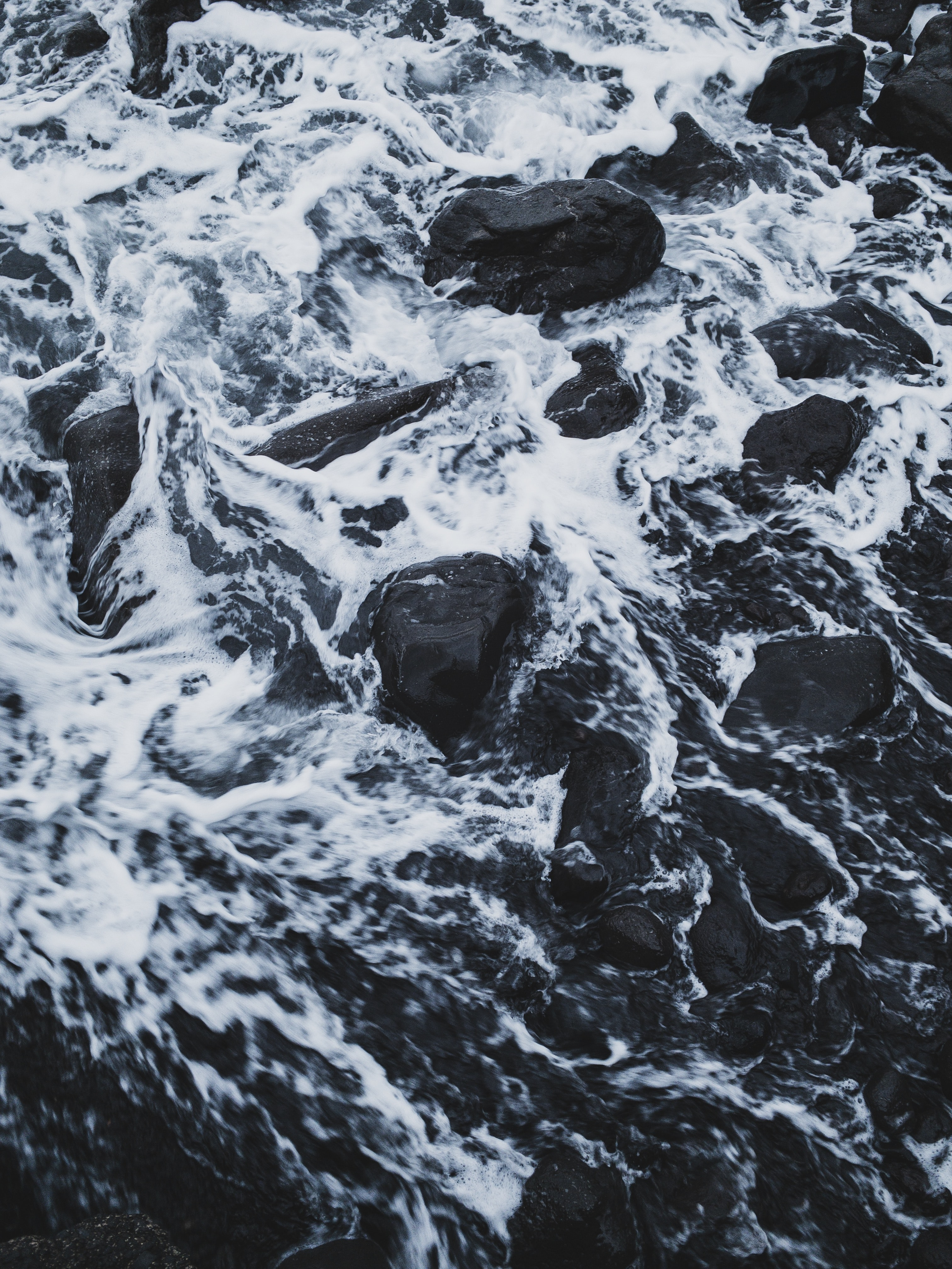 flowing body of water passing through rocks
