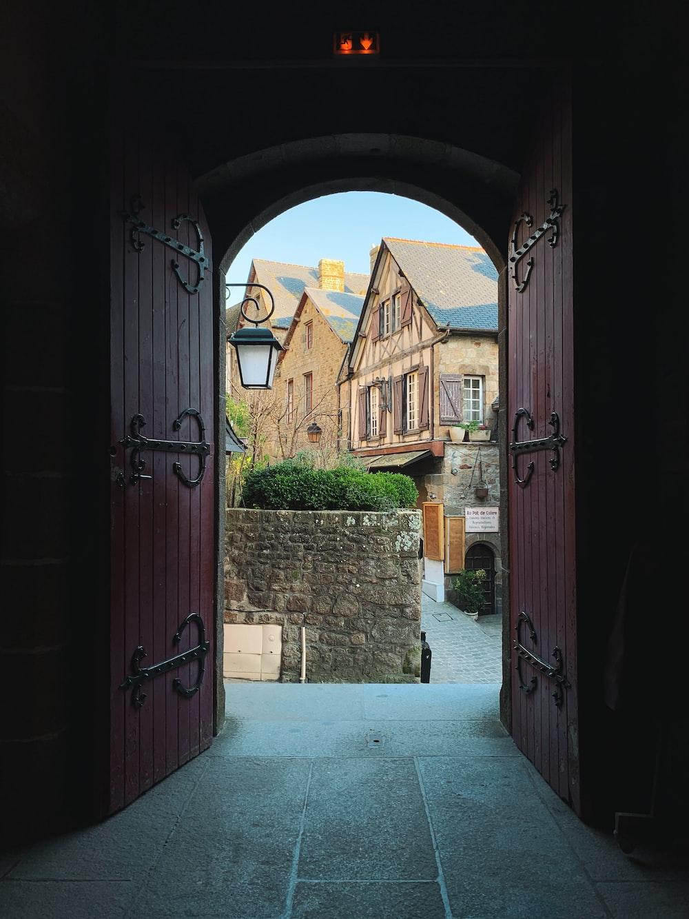 opened red wooden doors