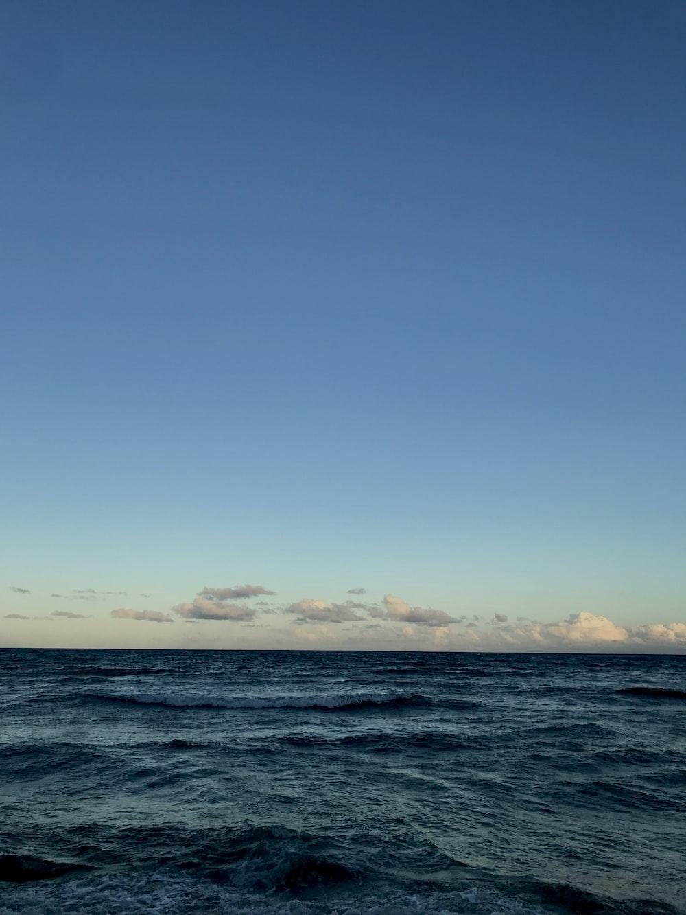 beach under blue sky during daytime