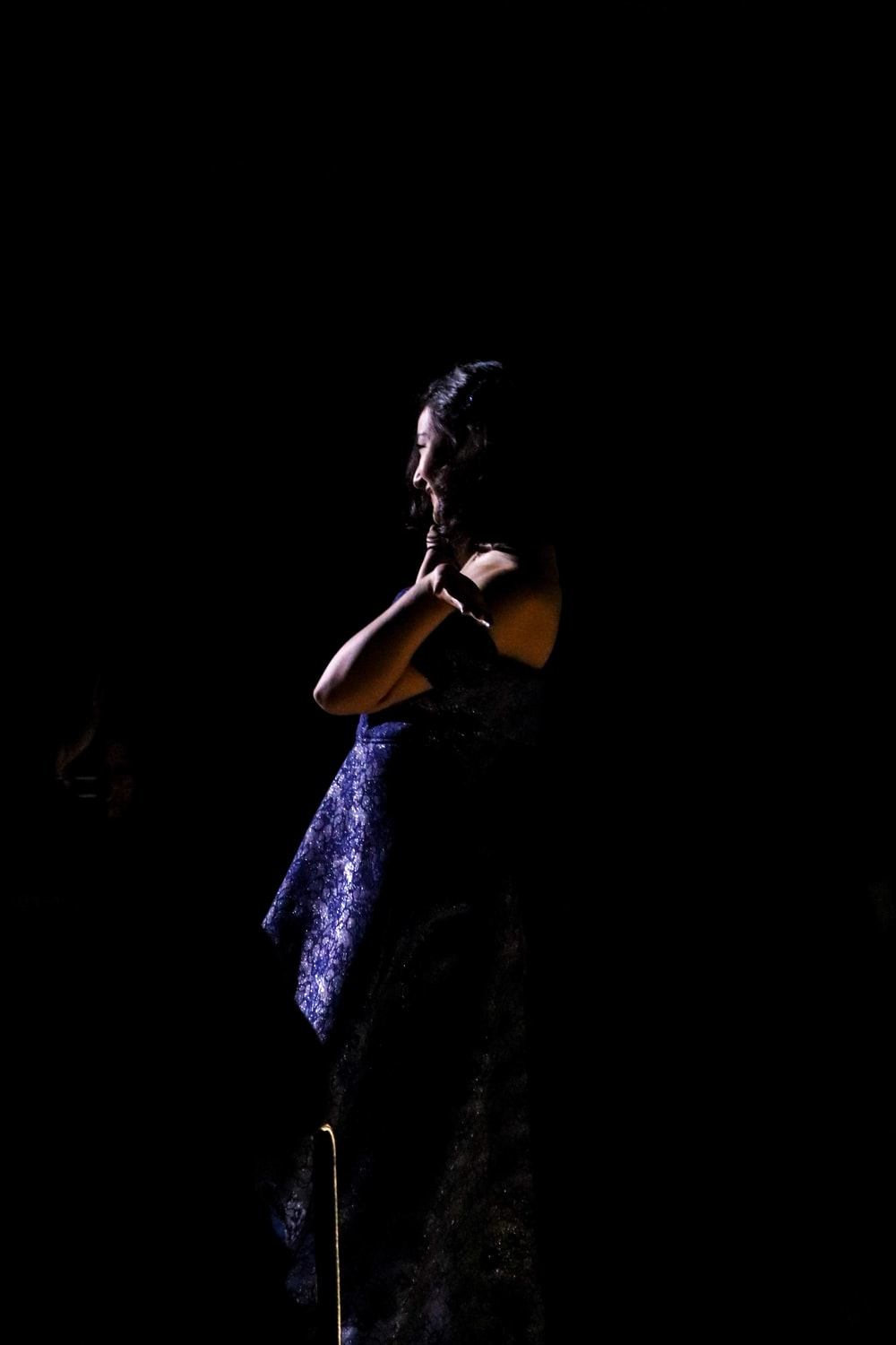 woman wearing blue gown in dim light
