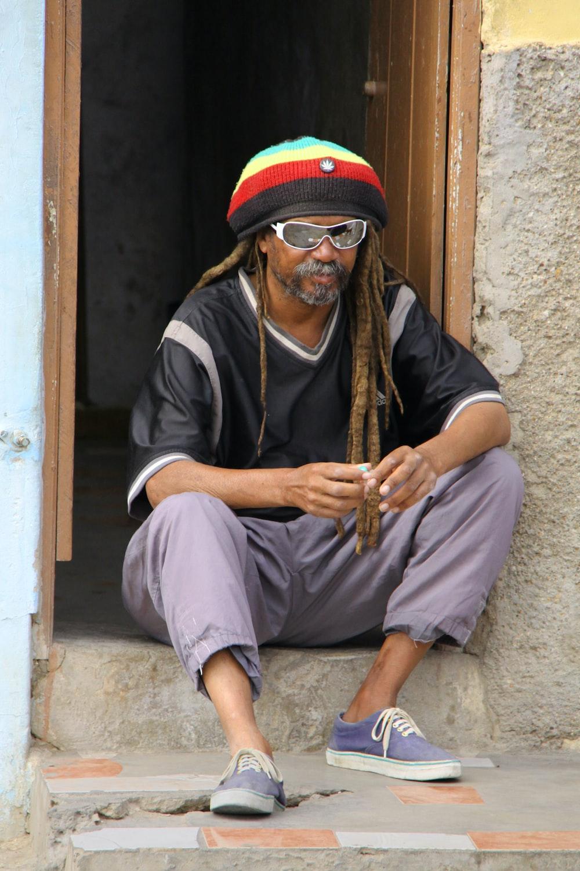 man sitting on door surface