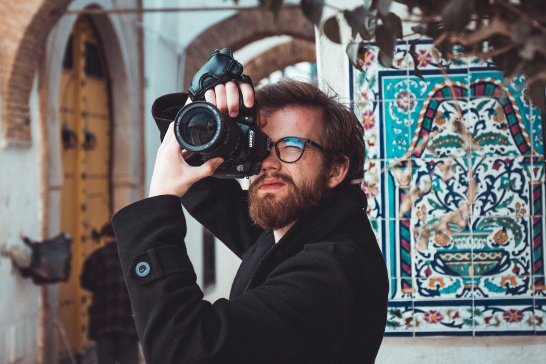 Photographer with blue tiles