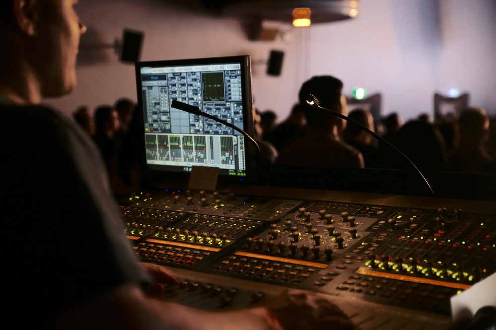 man in front of mixing console
