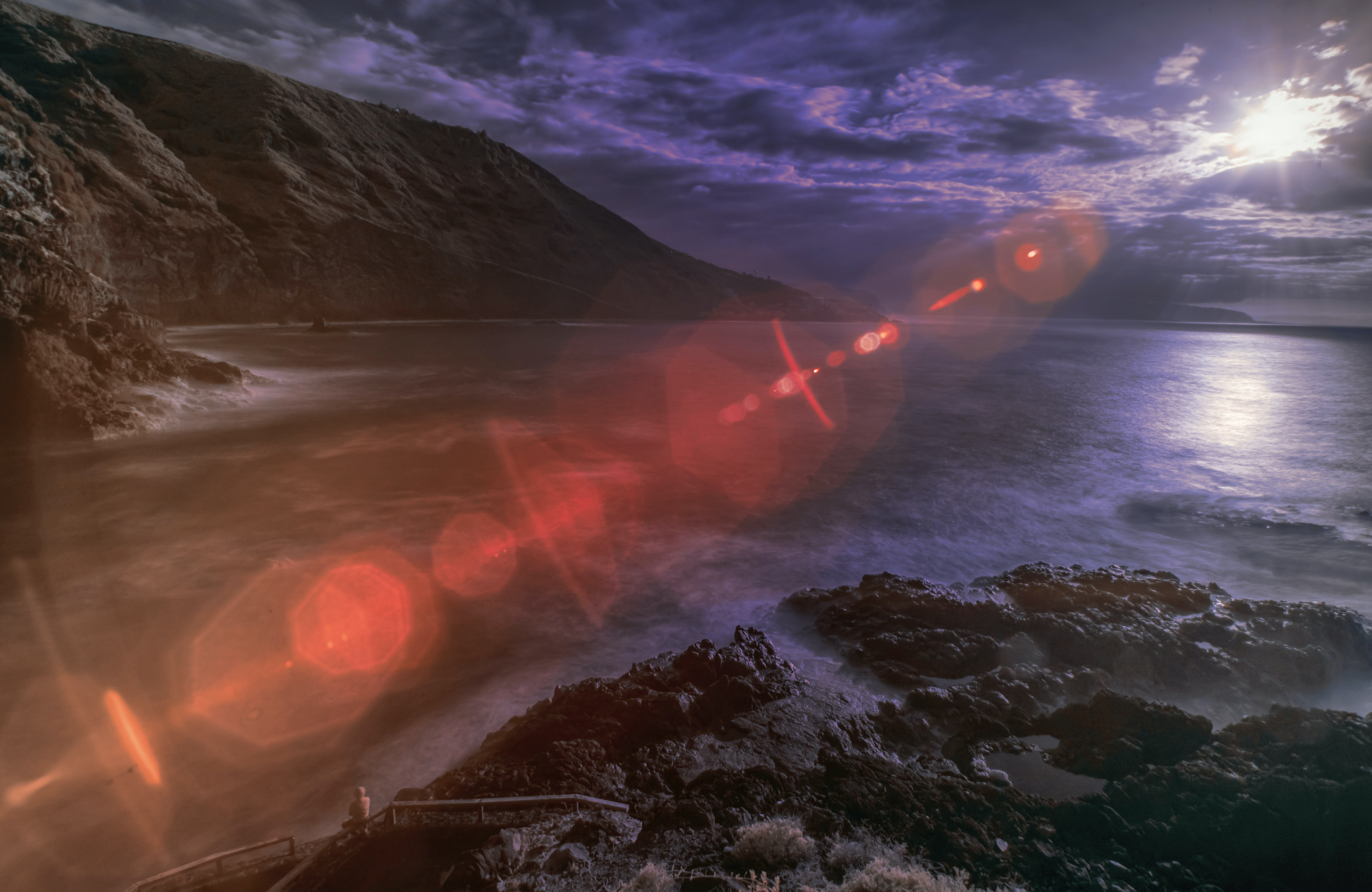 red light rays on beach