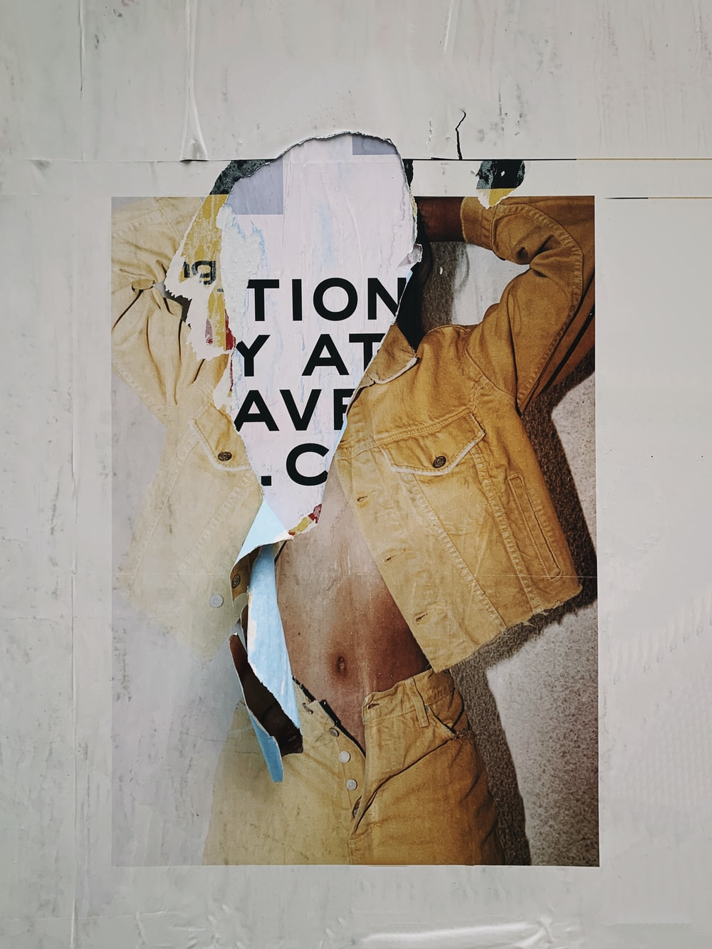 torn poster on the wall