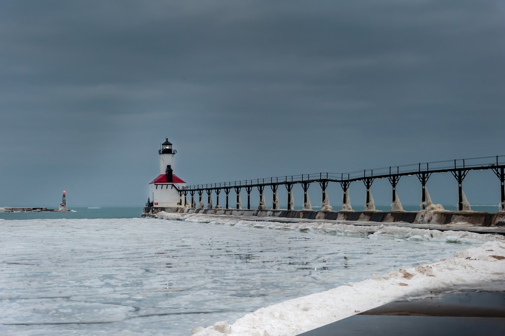 white and red lighthouse photography