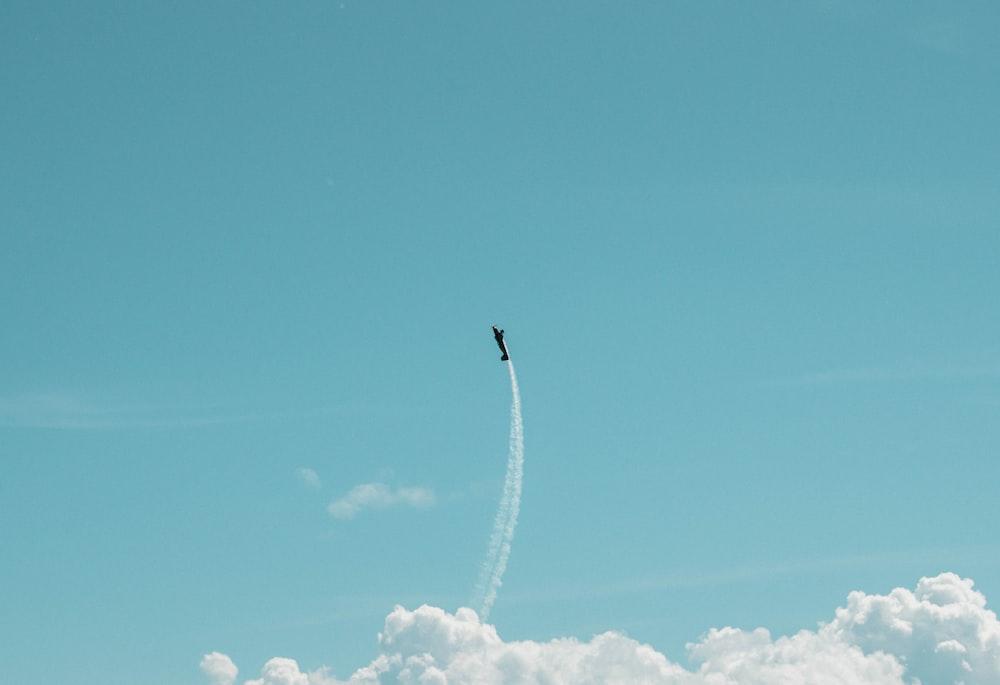 black plane under blue calm sky