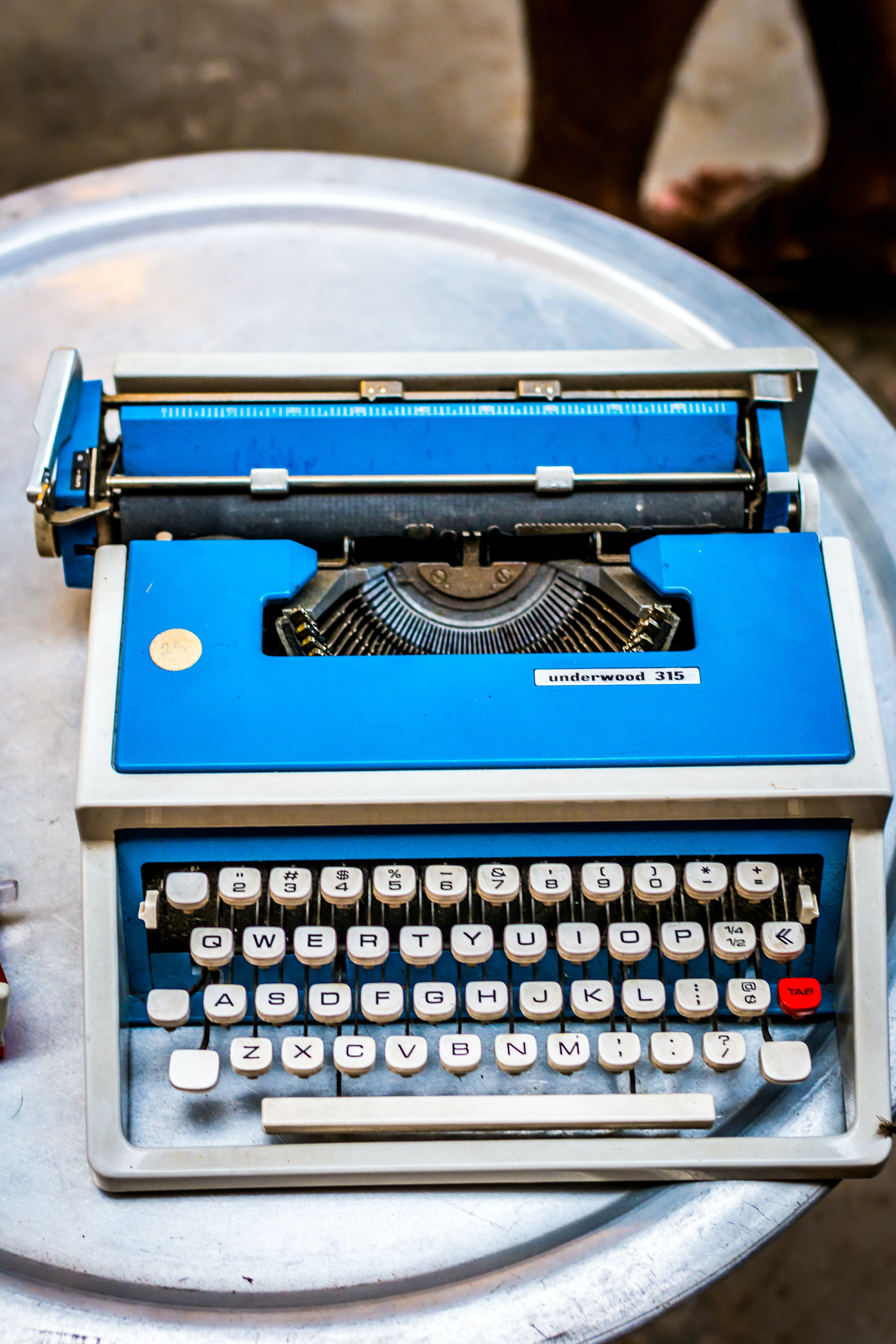 blue and white type writer