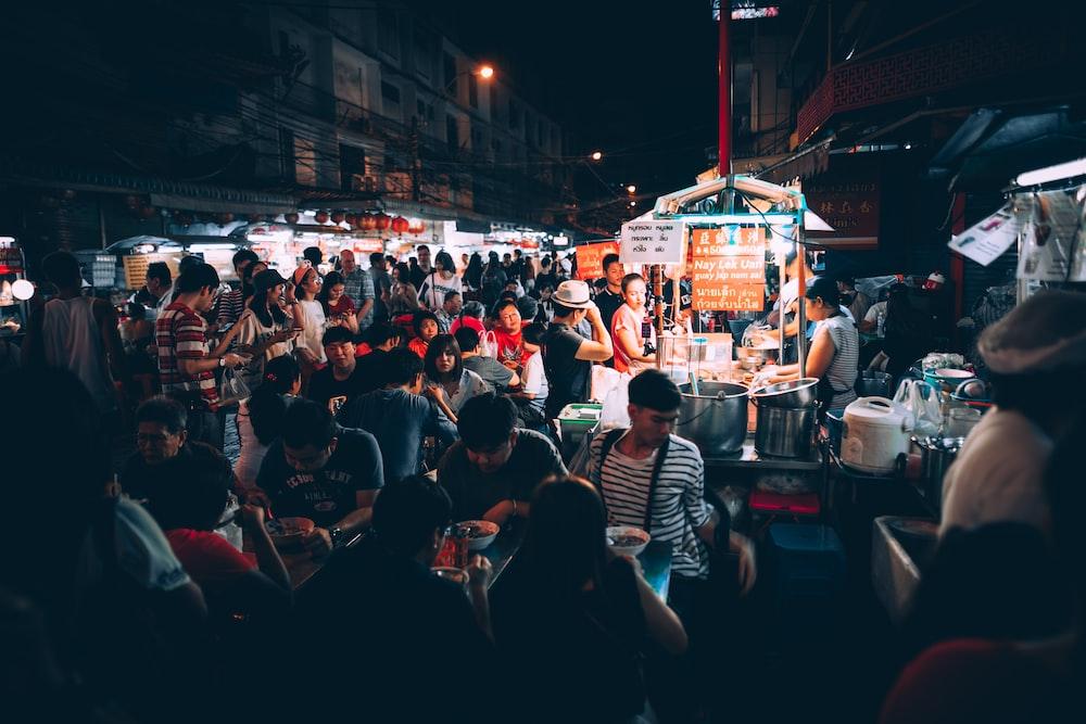 people eating on street