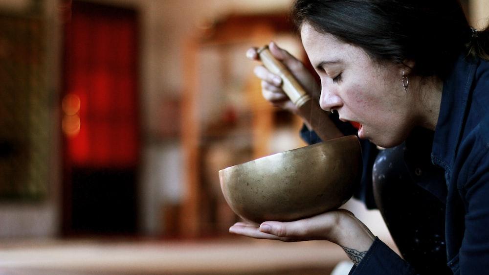 woman using singing bowl