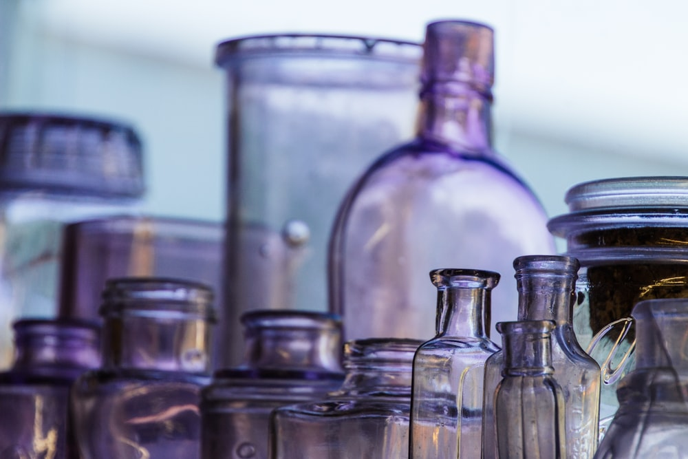 clear glass bottle lot in selective focus photography