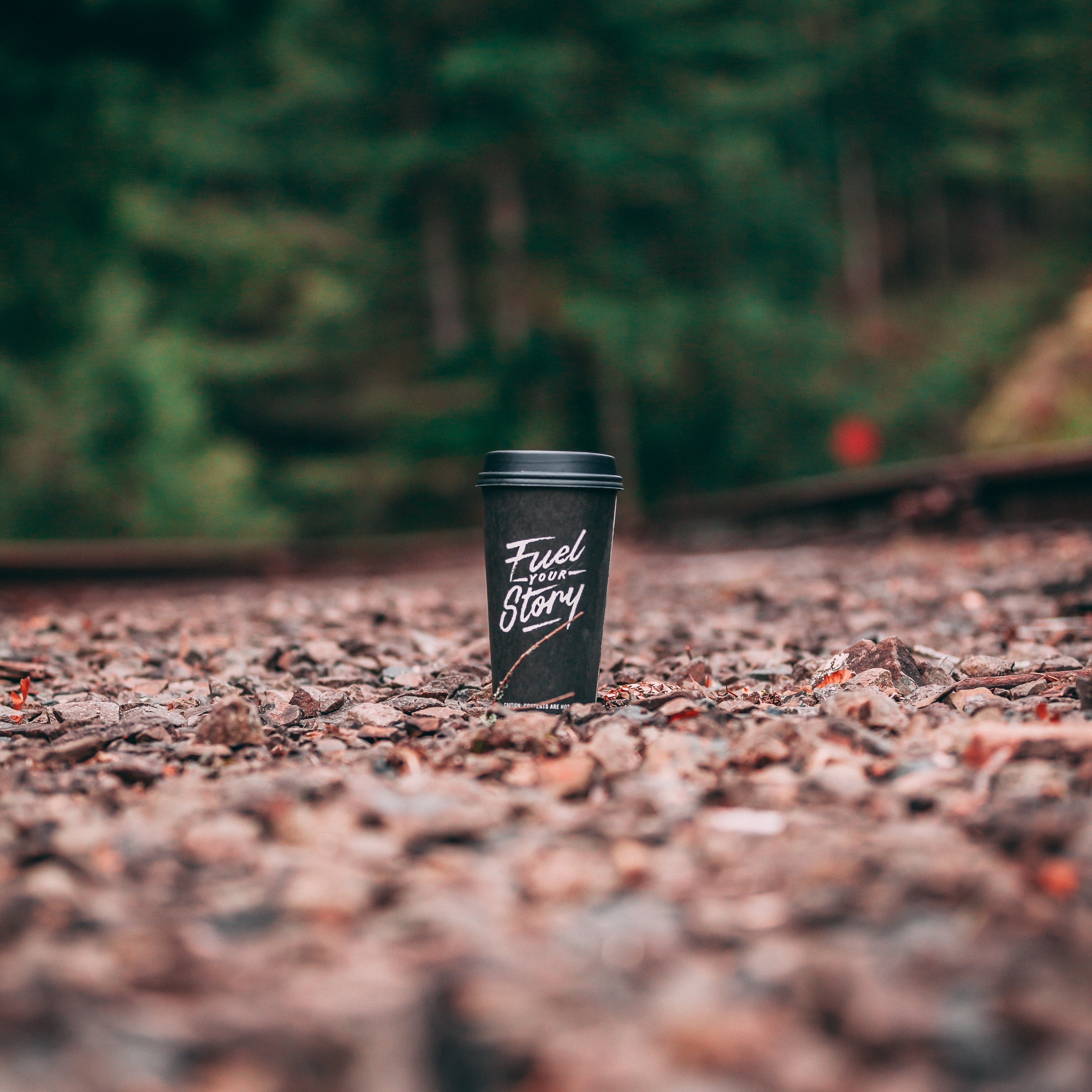 Fuel Story graphic tumbler on ground during daytime