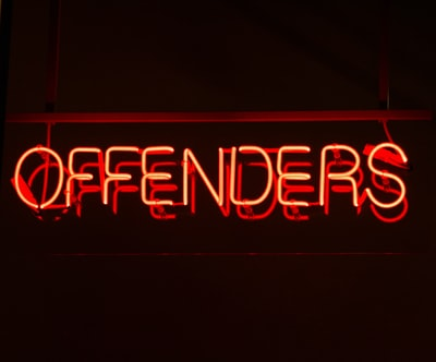 red neon lighted offenders signage civil right zoom background