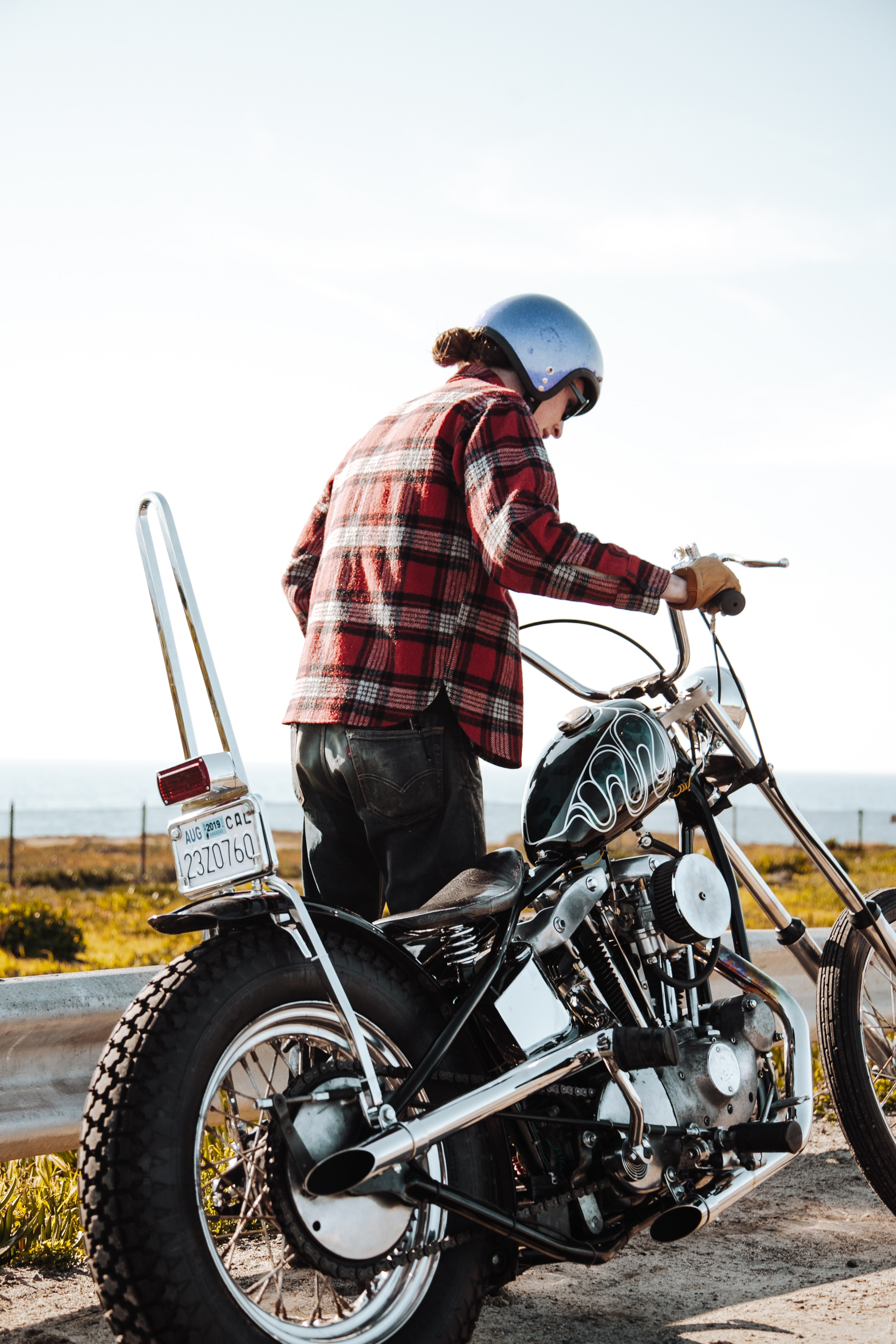 man about to ride chopper motorcycle