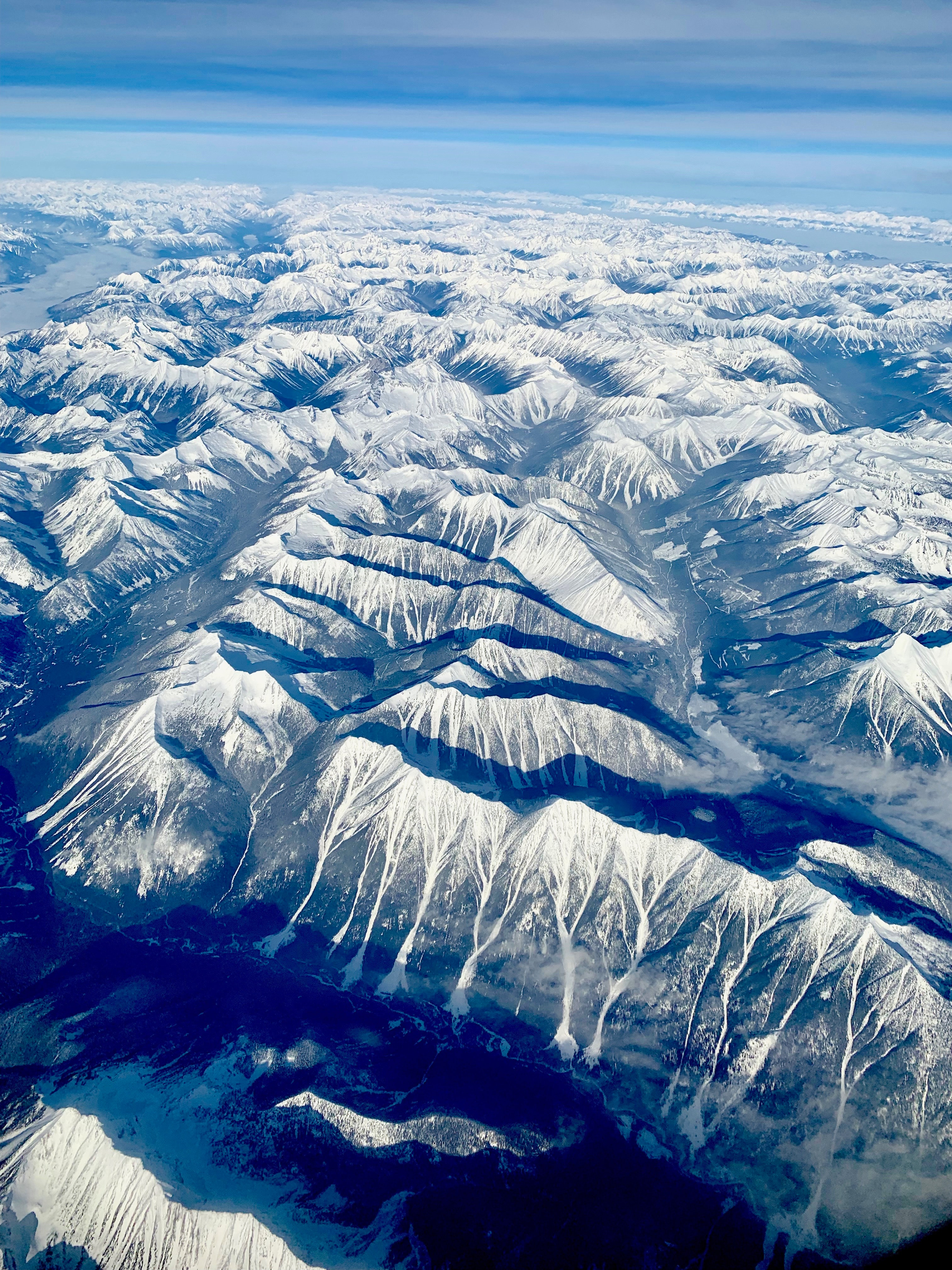 aerial photo of mountains near body of water during daytime