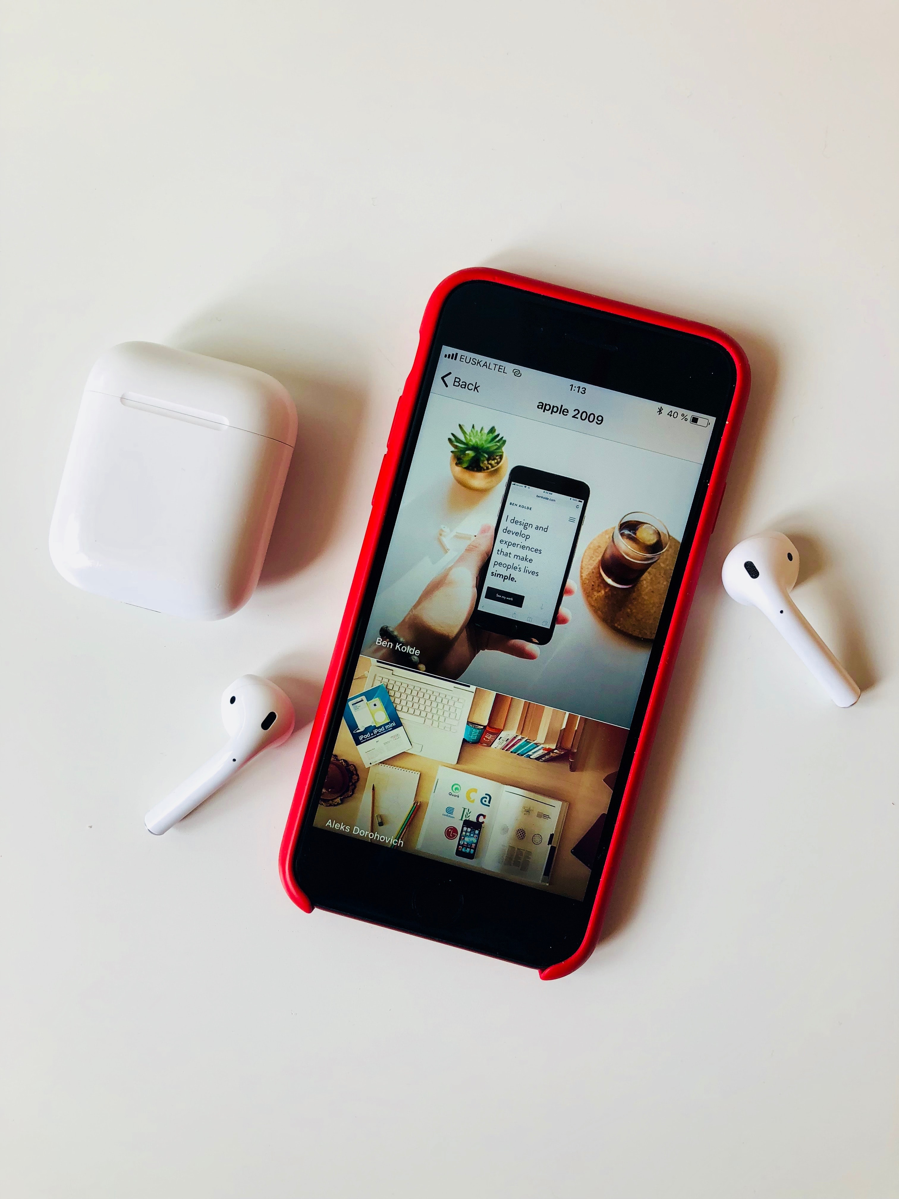 flat lay photography of iPhone beside AirPods