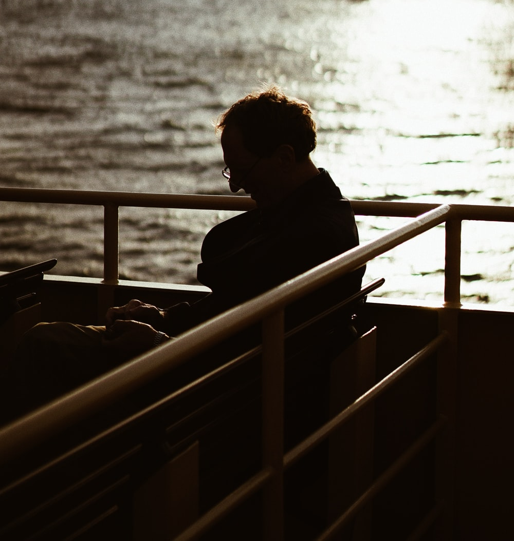 silhouette photography of man sitting