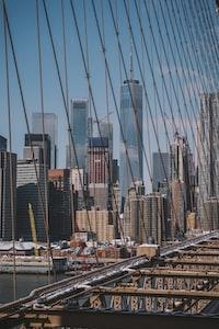 gray bridge near high rise buildings