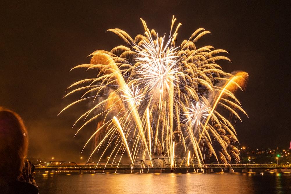 fireworks at nighttime over bridge
