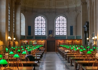 lighted green lamps on tables