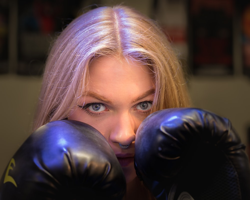 woman wearing black leather boxing gloves