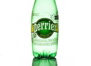 green \Perrier glass drink bottle