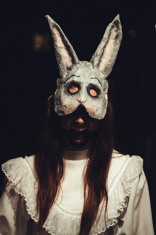woman wearing gray rabbit mask