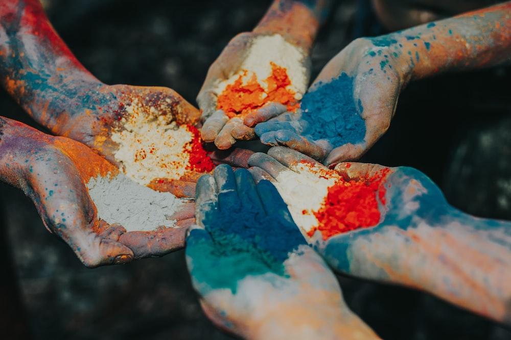 color powder on palms
