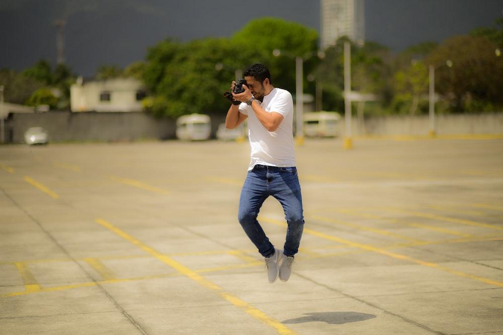 man taking photo while on air