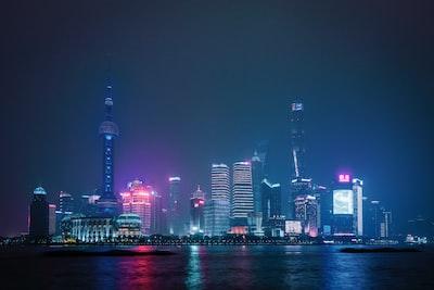 lighted city skyline during night futurism zoom background