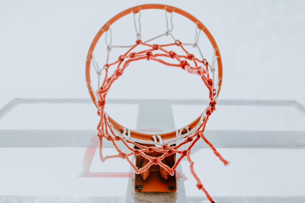 low-angle photography of basketball ring