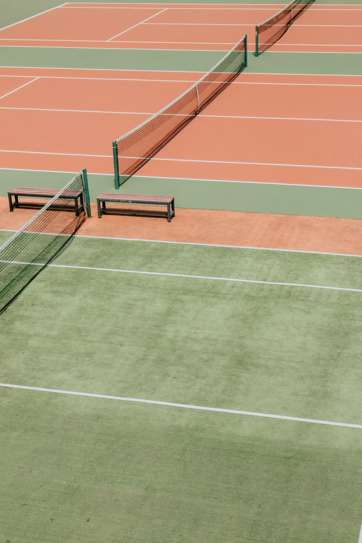 empty green and orange tennis fields