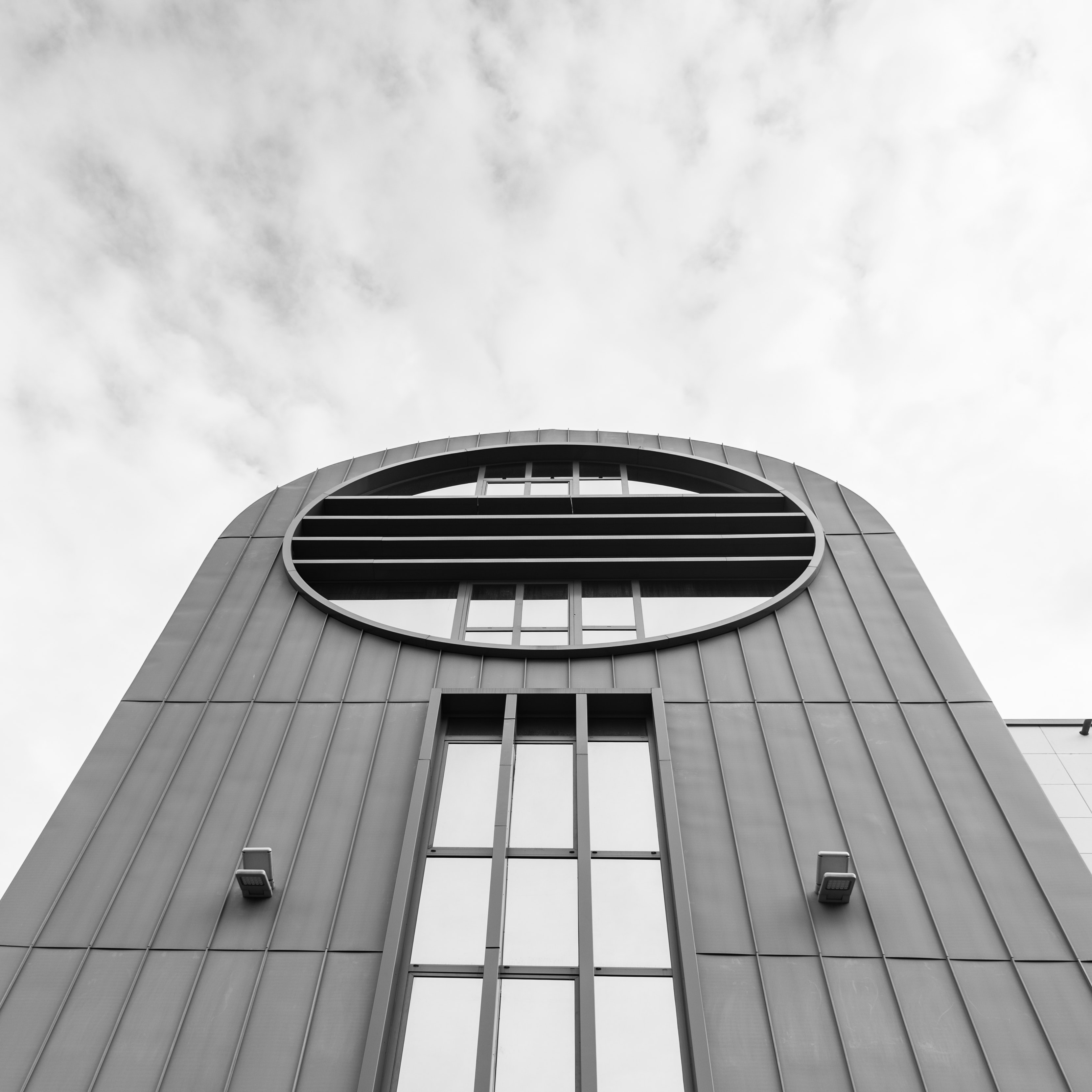 low-angle photography of concrete building under cloudy sky