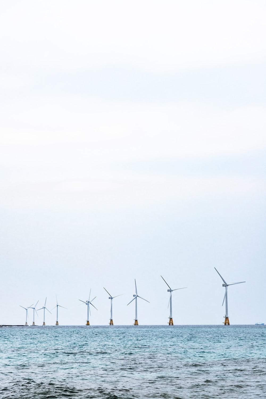 windmill near beach during daytime