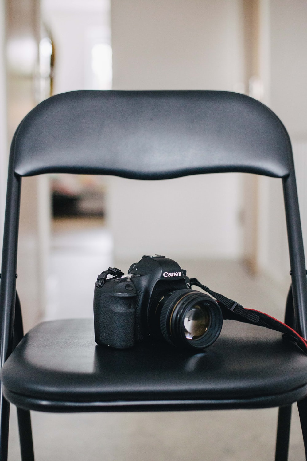 black DSLR camera on the chair