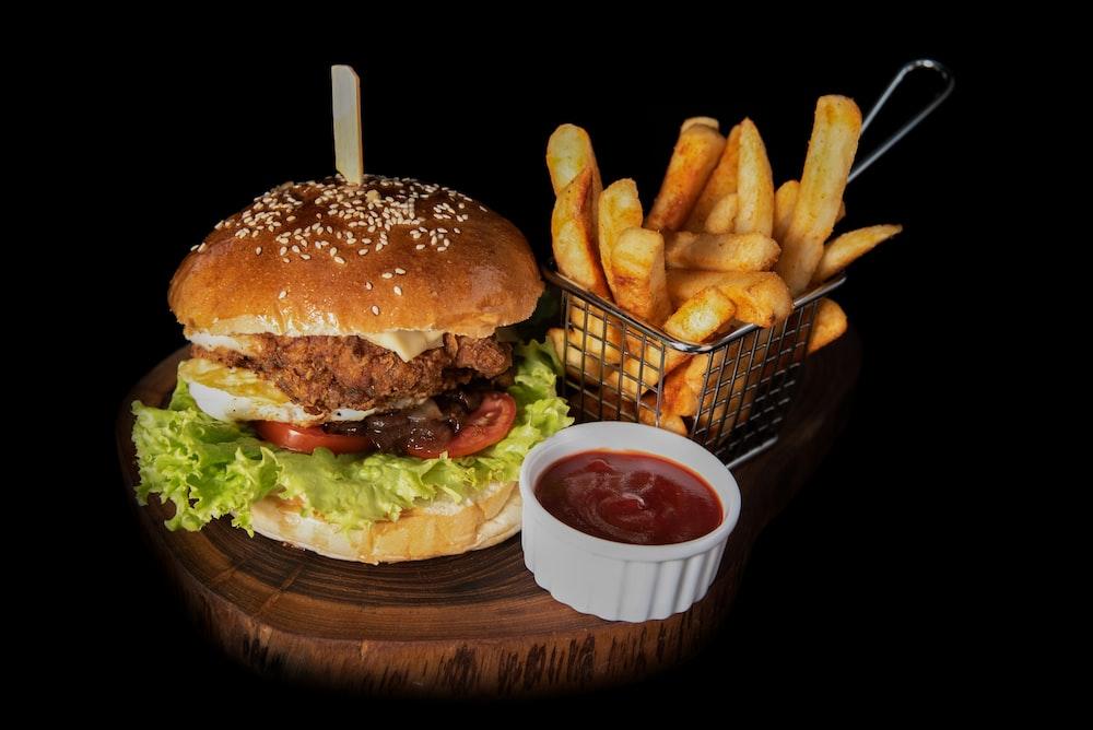 hamburger beside fries and ketchup