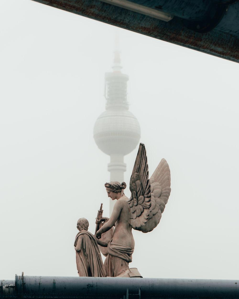 statue near mosque
