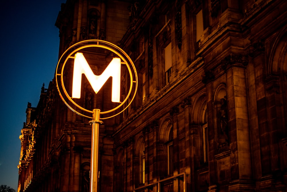 lighted M street sign