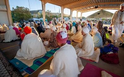 people sitting on floor while praying photo ramadan zoom background