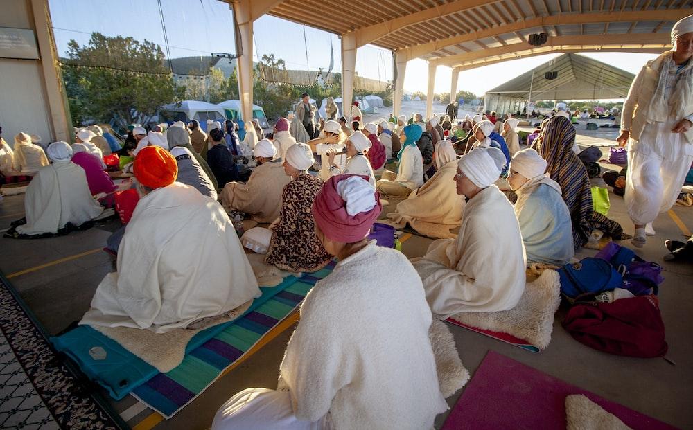 people sitting on floor while praying photo