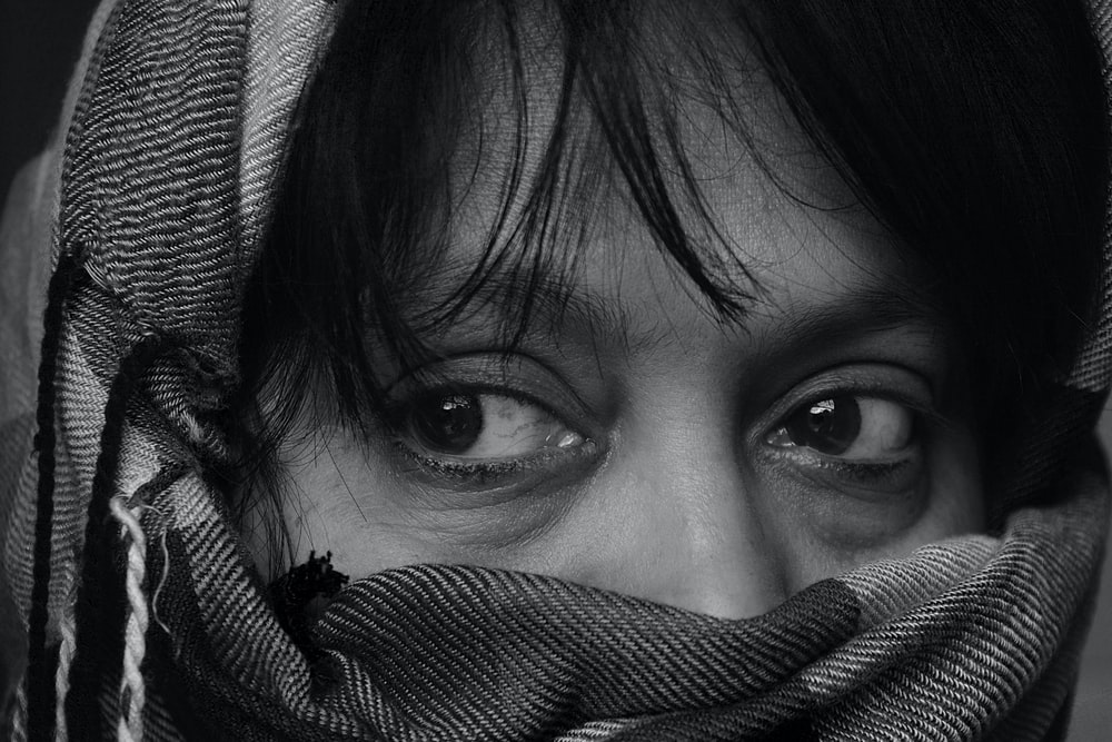 close view of person covered with scarf