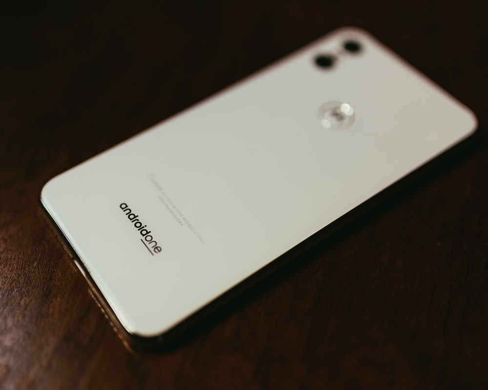 white Android One smartphone on table