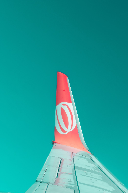 orange and grey airplane wing
