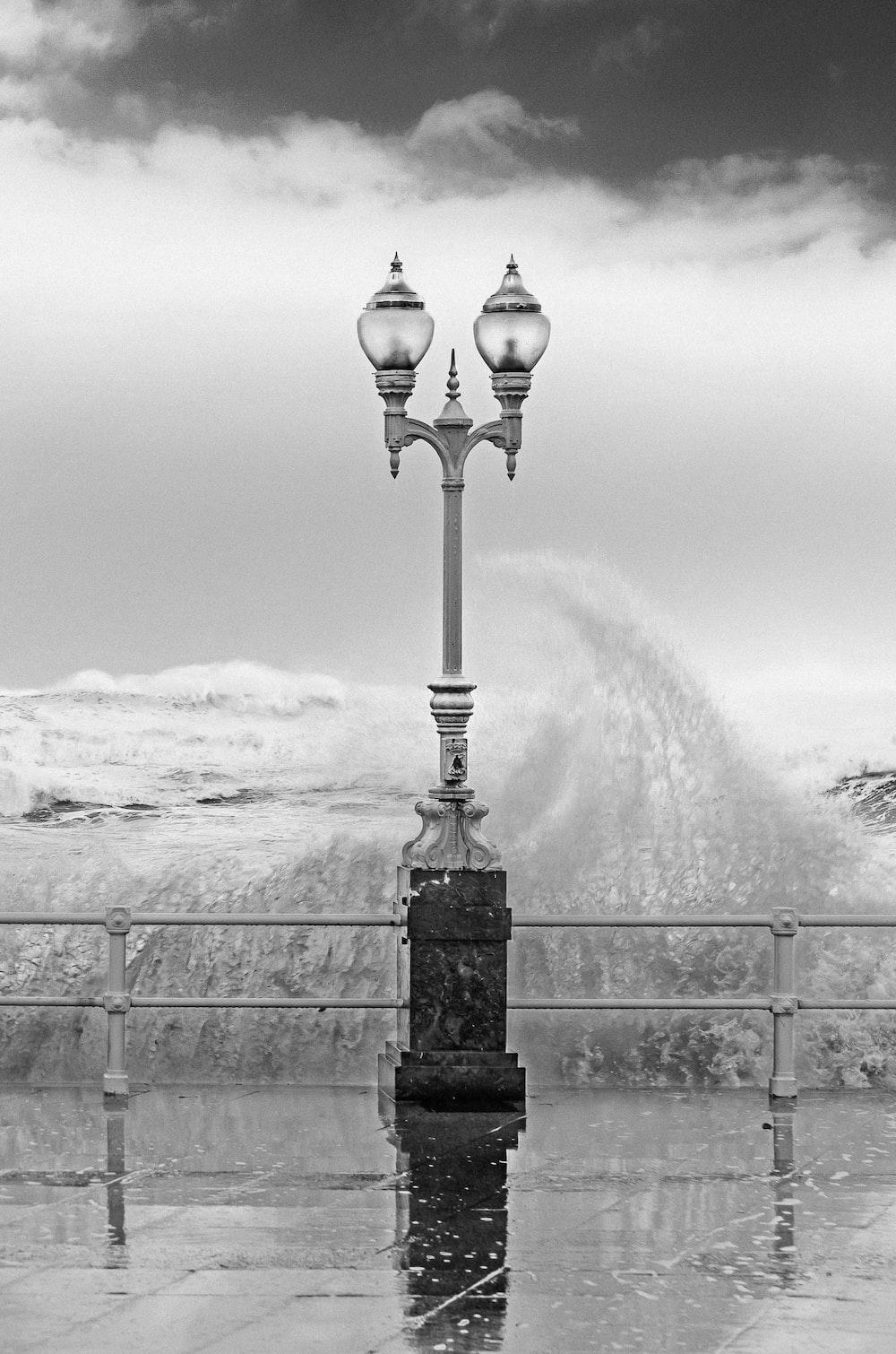 grayscale photo of streetlight