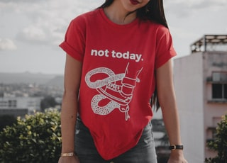 woman wearing red crew-neck with not today printed text