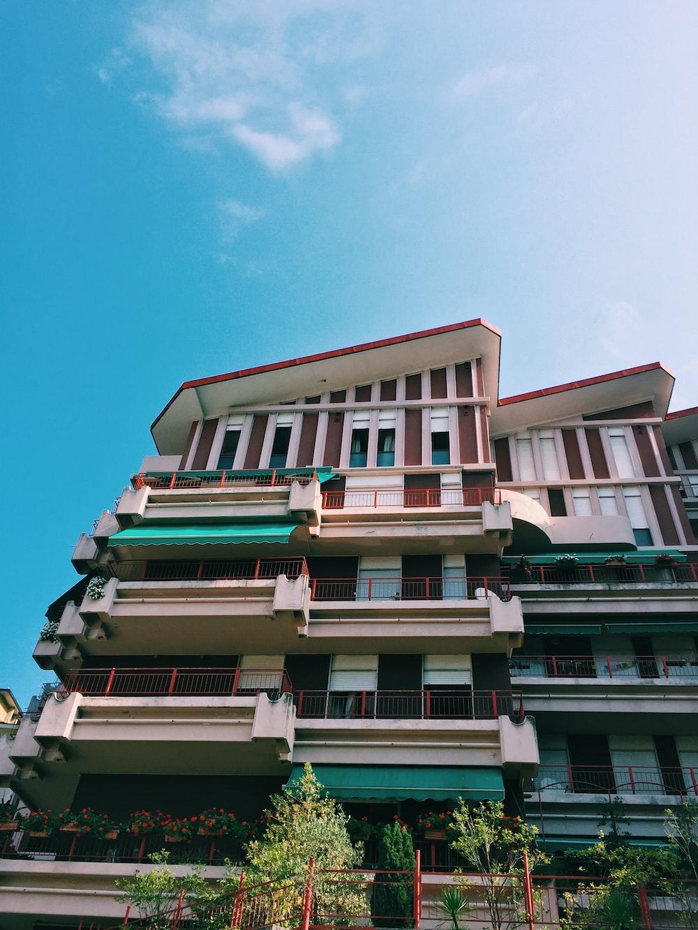 white concrete building underneath clear blue sky