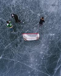 three people walking on ice